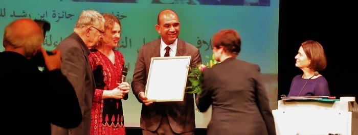 Picture of handing over the award to Aman